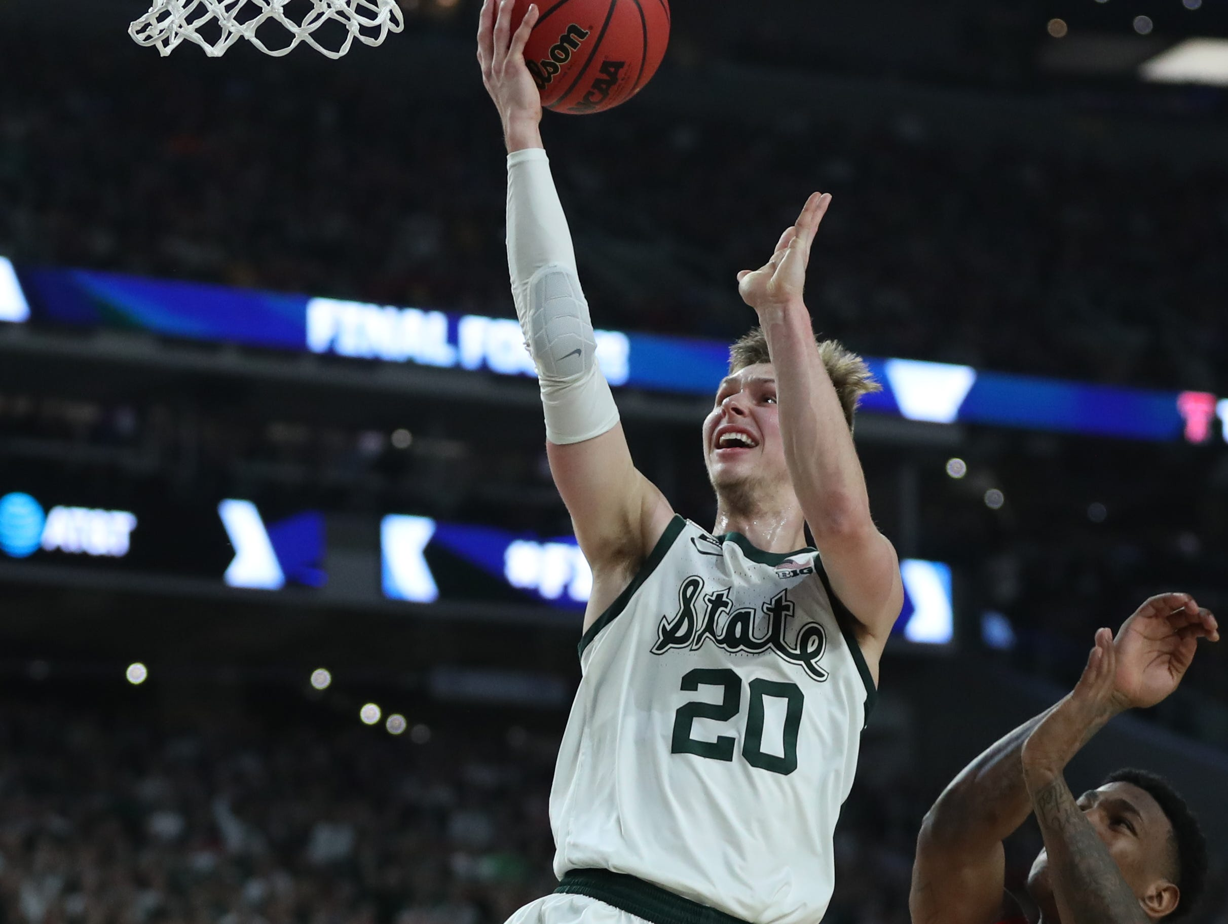 Michigan State guard Matt McQuaid (20) looks for a basket around Texas Tech forward Deshawn Corprew (3) in the first half of the Spartan's Final Four game at U.S. Bank Stadium in Minneapolis, Minnesota on Saturday, April 06, 2019.