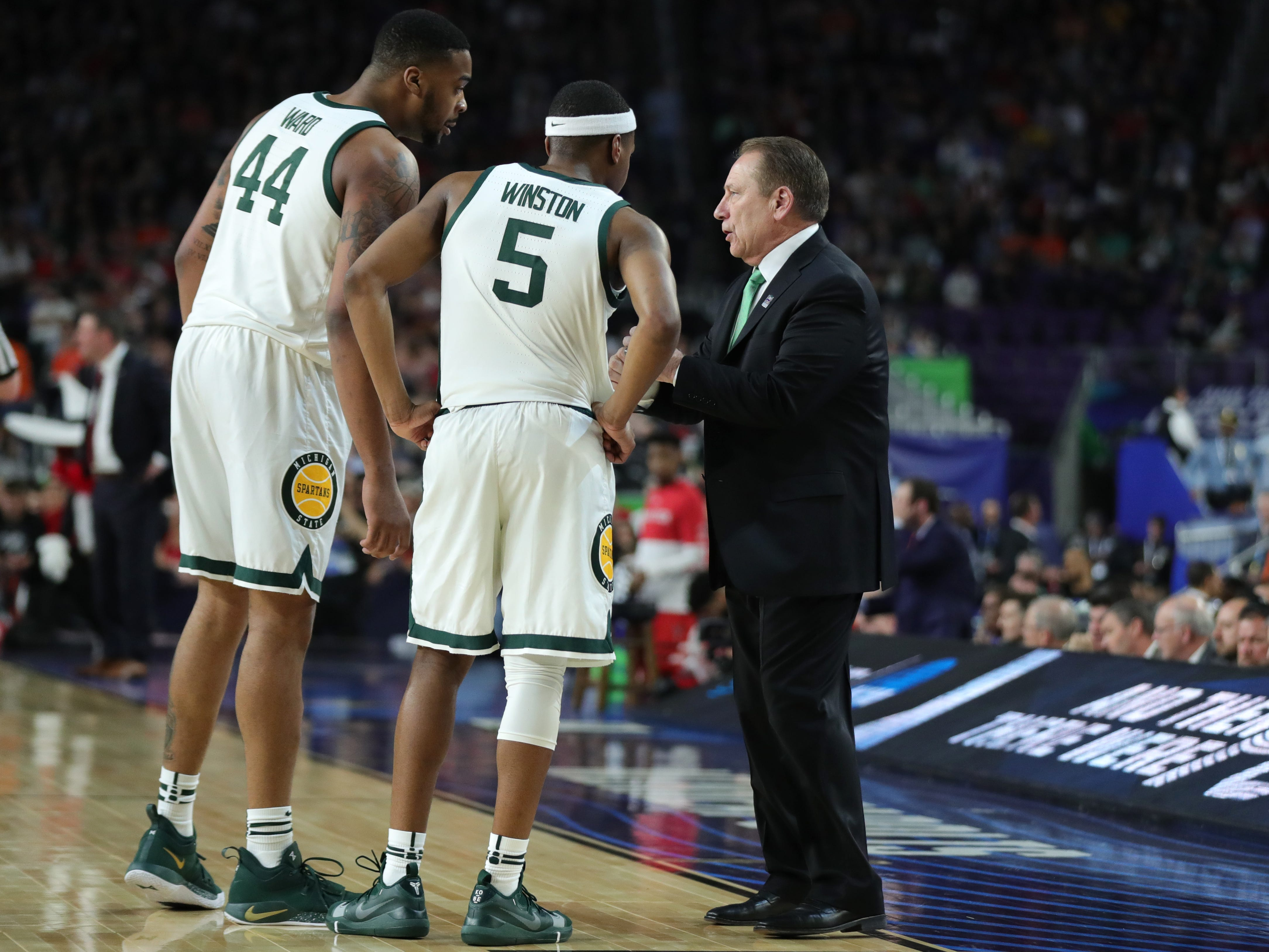Michigan State head coach Tom Izzo speaks with Nick Ward and Cassius Winston during the first half of the Final Four game against Texas Tech at U.S. Bank Stadium in Minneapolis, Minnesota on Saturday, April 06, 2019.