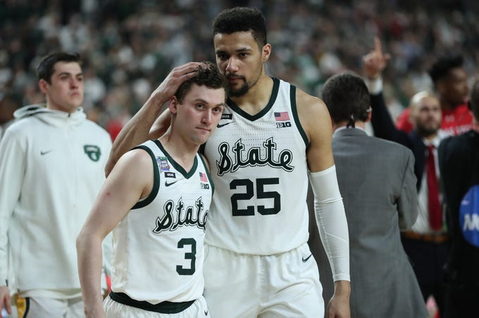 Michigan State guard Foster Loyer (3) and forward Kenny Goins (25) walk off the court after losing to Texas Tech, 61-51, in the Final Four at U.S. Bank Stadium in Minneapolis, Minnesota on Saturday, April 6, 2019.