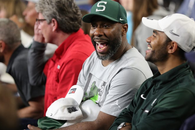 Former Michigan State stars Mateen Cleaves, left, and Chris Hill chat before Michigan State's Final Four game at U.S. Bank Stadium in Minneapolis.
