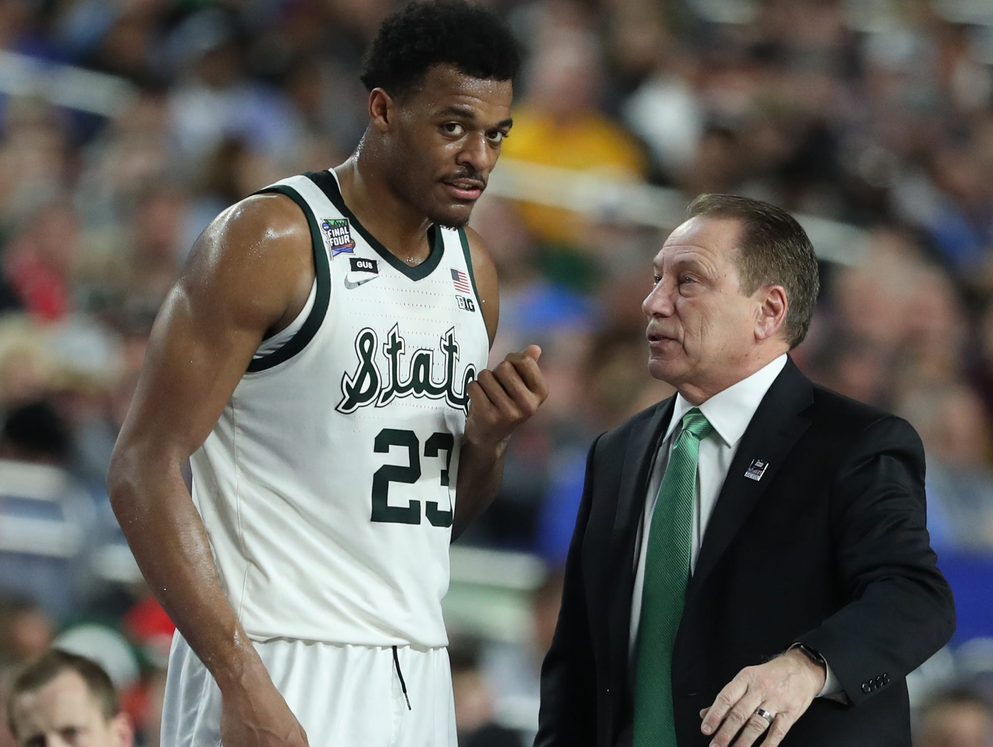 Michigan State forward Xavier Tillman (23) speaks with head coach Tom Izzo  during a break in the action in the first half of their Final Four game against Texas Tech at U.S. Bank Stadium in Minneapolis, Minnesota on Saturday, April 06, 2019.