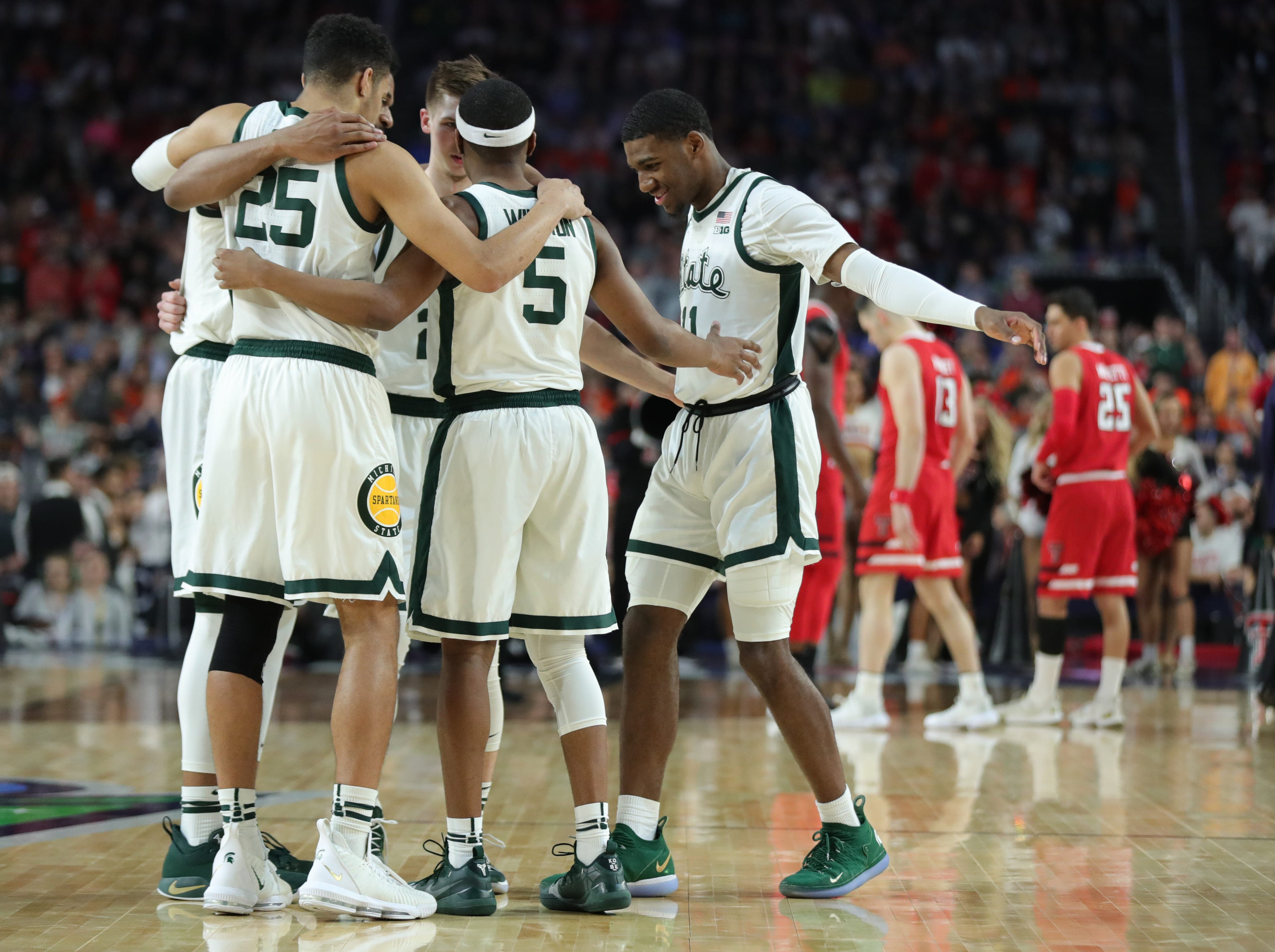 Michigan State;s starters join for a huddle before tip off against Texas Tech in the Final Four at U.S. Bank Stadium in Minneapolis, Minnesota on Saturday, April 06, 2019.