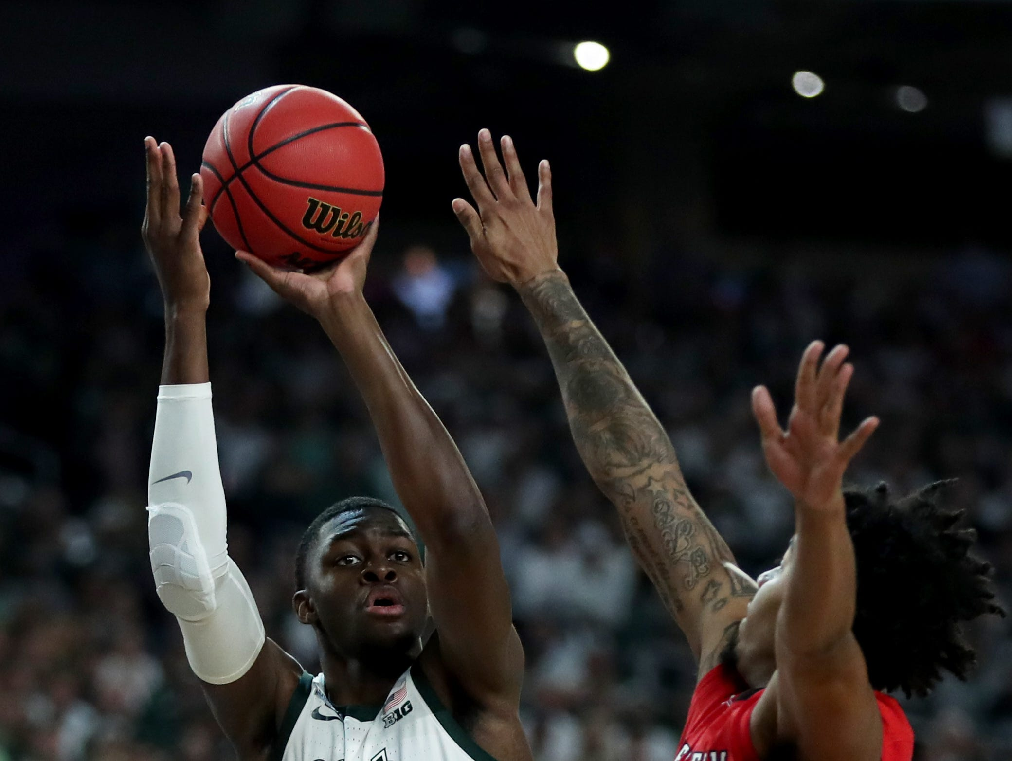 Michigan State forward Gabe Brown (13) shoots the ball over guard Kyler Edwards (0) in the first half of the Spartan's Final Four game at U.S. Bank Stadium in Minneapolis, Minnesota on Saturday, April 06, 2019.
