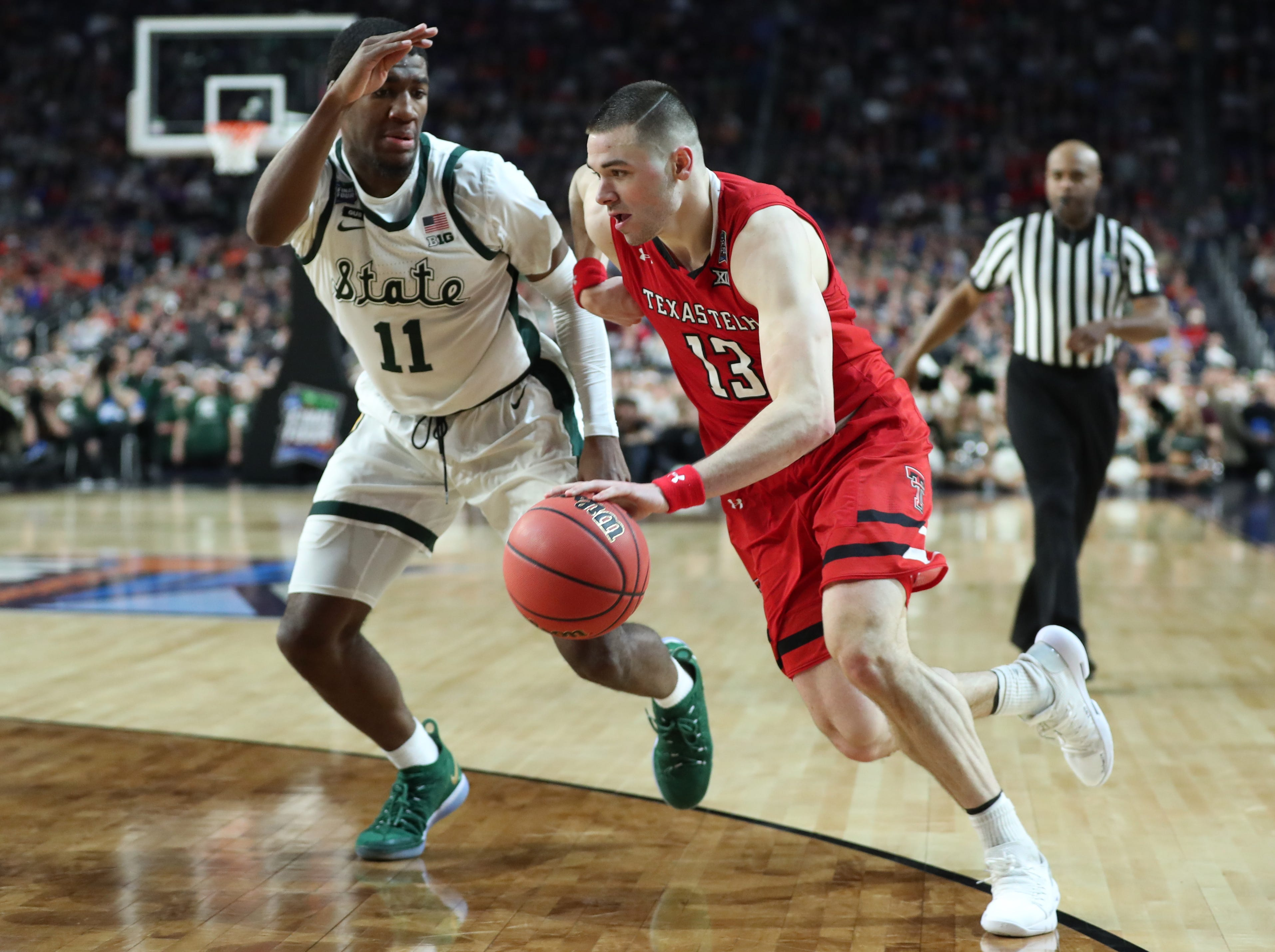Michigan State forward Aaron Henry (11) guards Texas Tech guard Matt Mooney (13) in the second half of the Final Four game at U.S. Bank Stadium in Minneapolis, Minnesota on Saturday, April 06, 2019.