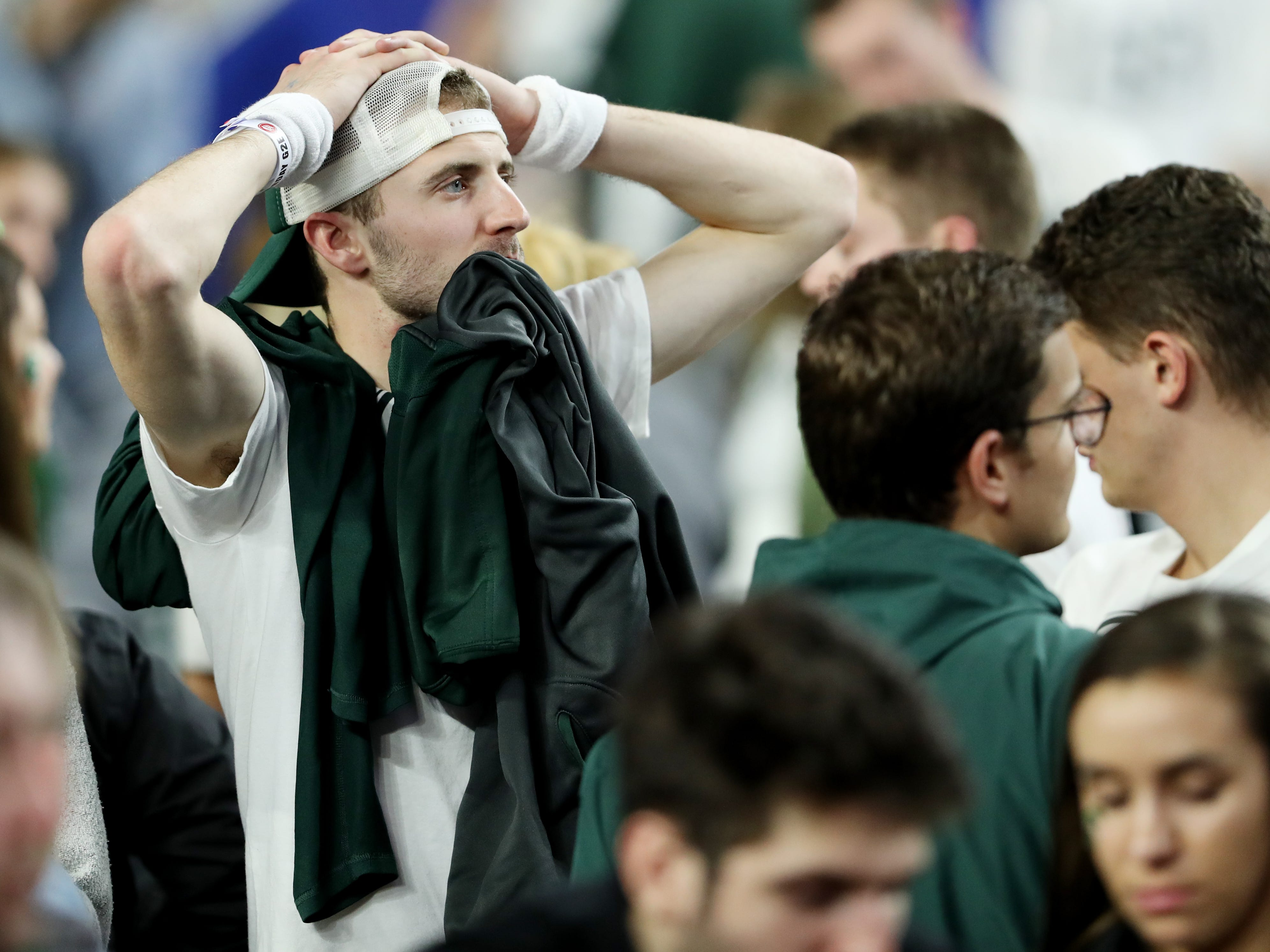 A Michigan State reacts after the Spartan's lost to Texas Tech in the Final Four at U.S. Bank Stadium in Minneapolis, Minnesota on Saturday, April 6, 2019.