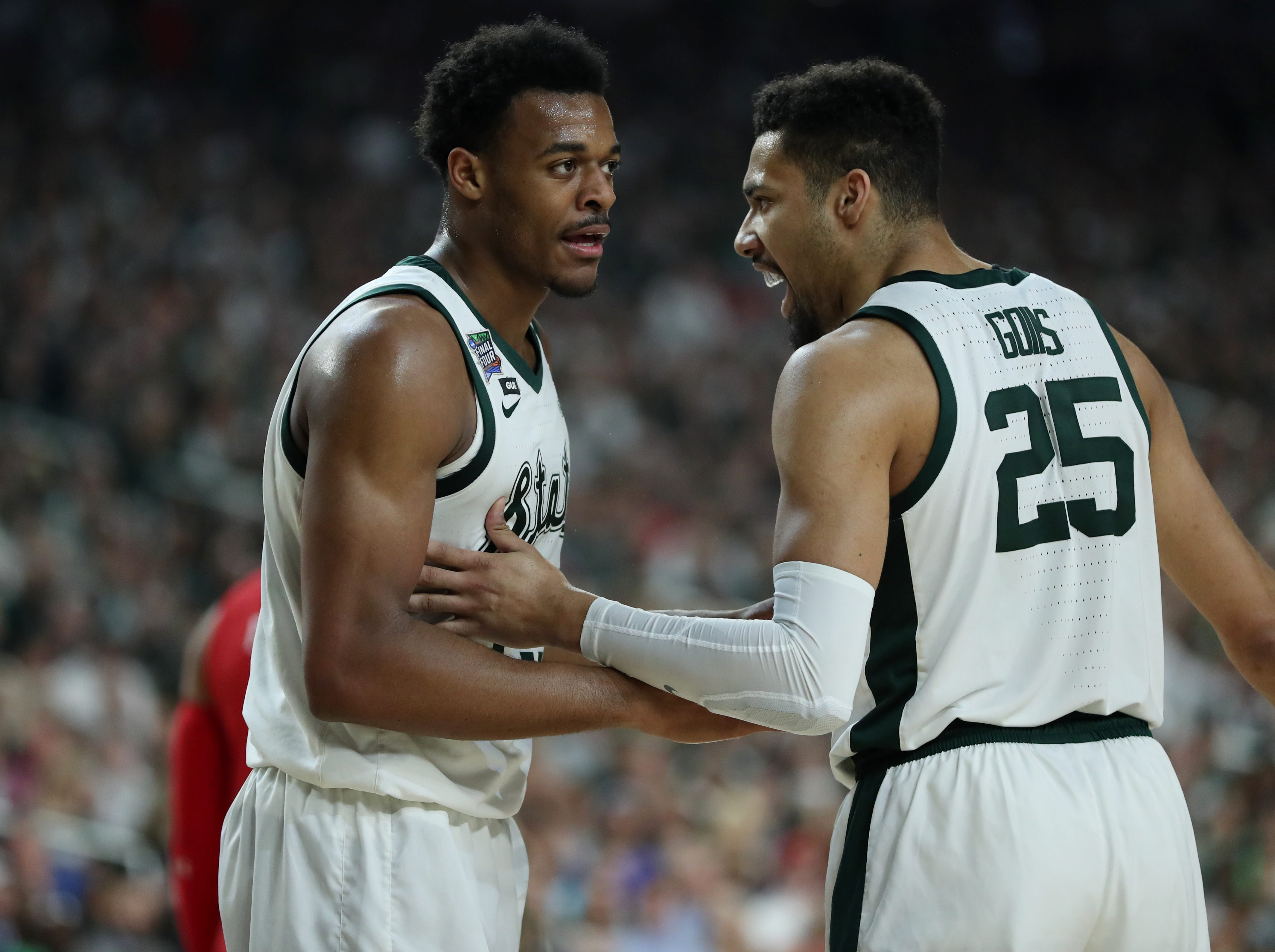 Michigan State forward Xavier Tillman (23) and forward Kenny Goins (25) chat during a break in the action in the first half of their Final Four game -against Texas Tech at U.S. Bank Stadium in Minneapolis, Minnesota on Saturday, April 06, 2019.