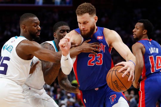 Blake Griffin drives to the basket against Hornets guard Kemba Walker (15) during the third quarter at LCA on Sunday.