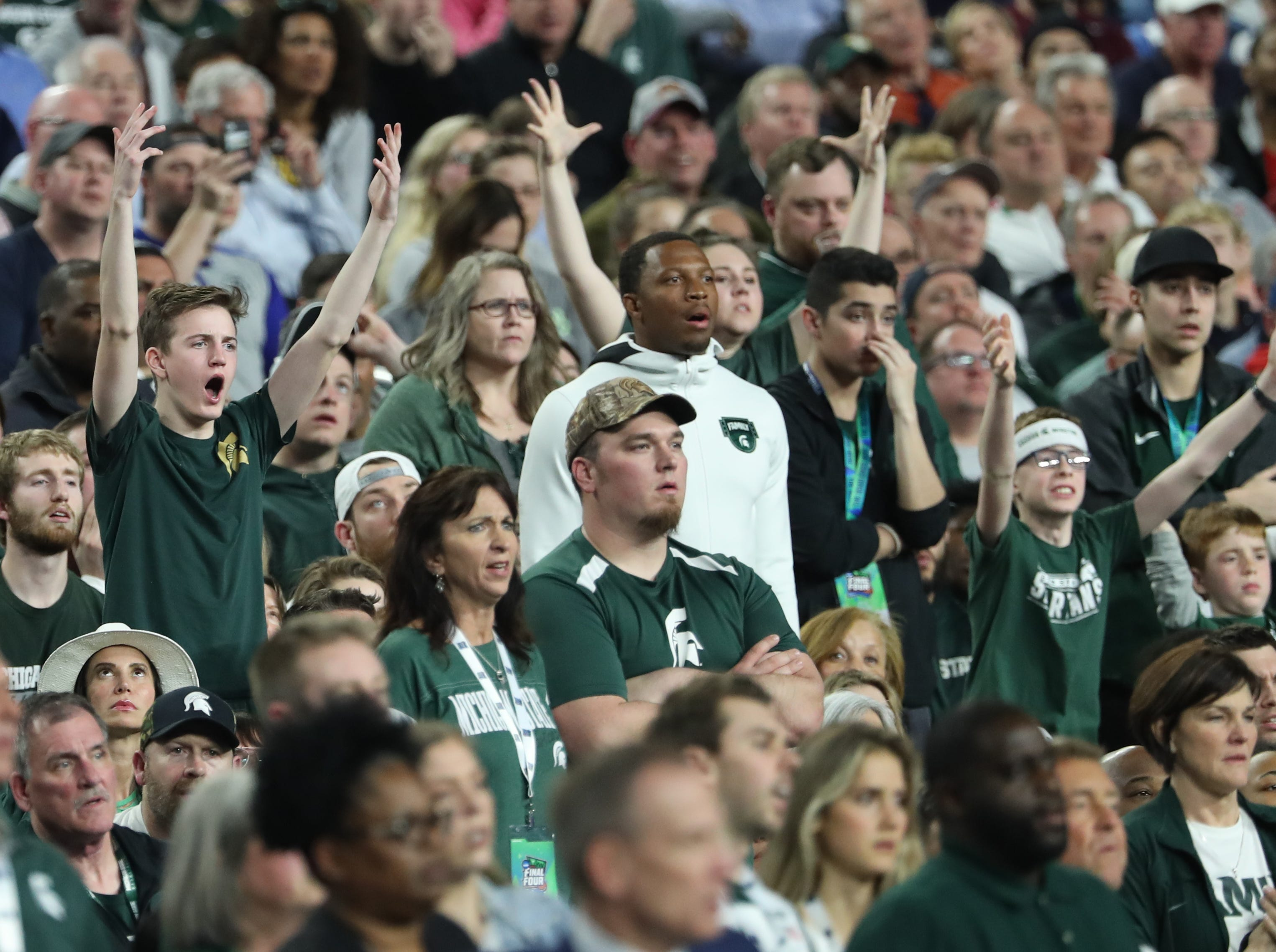 Michigan State fans react in the second half of the Spartan's Final Four game against Texas Tech at U.S. Bank Stadium in Minneapolis, Minnesota on Saturday, April 06, 2019.