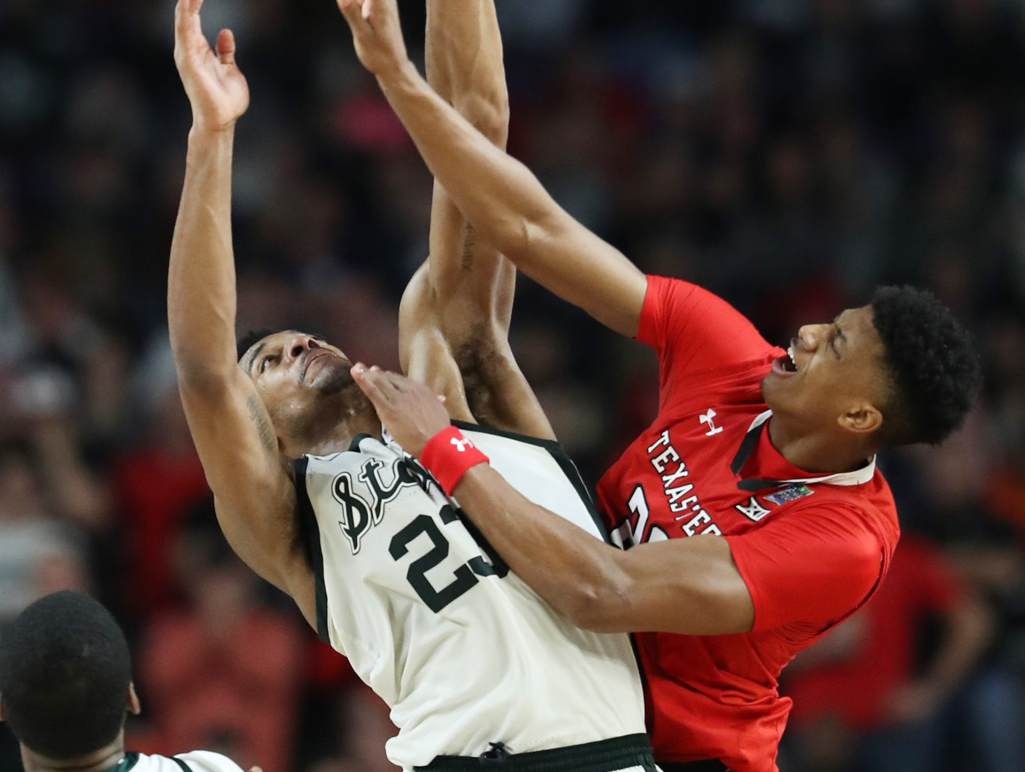 Michigan State forward Xavier Tillman (23) guards Texas Tech guard Jarrett Culver (23) in the second half of the Final Four game at U.S. Bank Stadium in Minneapolis, Minnesota on Saturday, April 06, 2019.