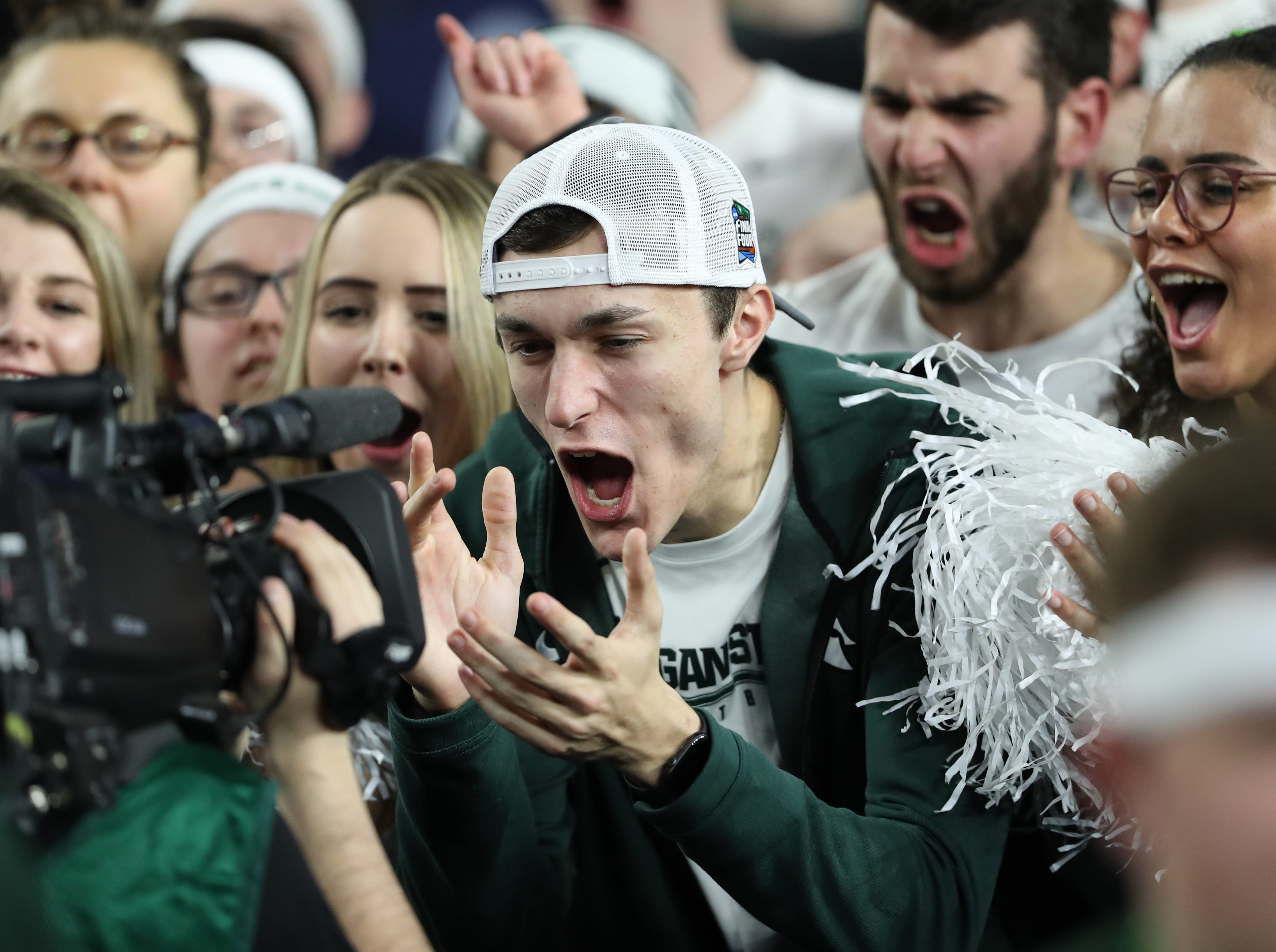 A Michigan State cheers for the camera before the start of their Final Four game against Texas Tech at U.S. Bank Stadium in Minneapolis, Minnesota on Saturday, April 06, 2019.