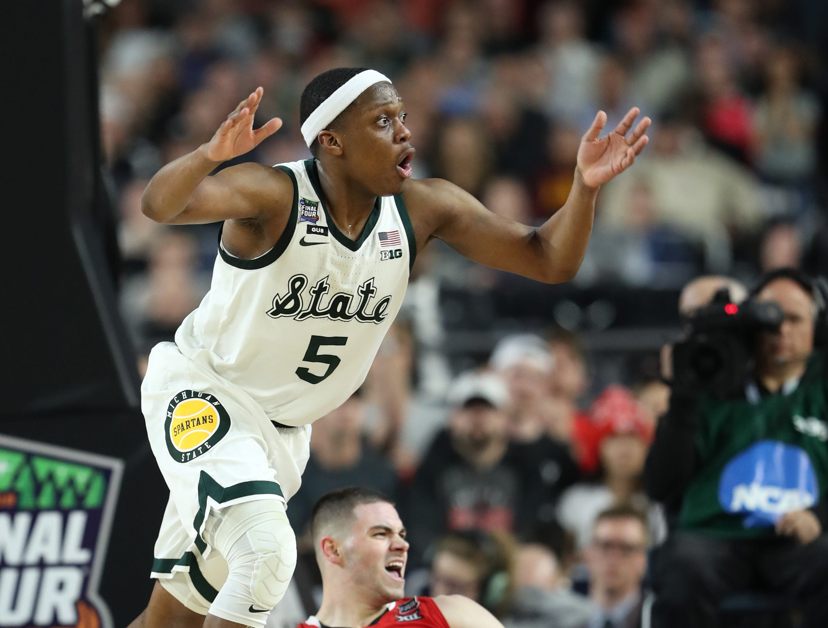 Michigan State guard Cassius Winston (5) reacts to a call as Texas Tech guard Matt Mooney (13) looks on in the second half of the Final Four game at U.S. Bank Stadium in Minneapolis, Minnesota on Saturday, April 06, 2019.