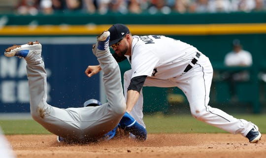 Royals catcher Cam Gallagher is tagged out by Detroit Tigers shortstop Jordy Mercer on an attempted double during the fifth inning on Sunday, April 7, 2019, at Comerica Park.