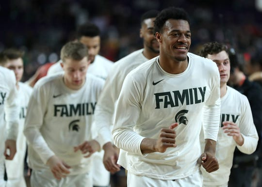Michigan State forward Xavier Tillman warms up with his teammates before the start of the Spartans' Final Four game against Texas Tech at U.S. Bank Stadium in Minneapolis, Minnesota on Saturday, April 6, 2019.