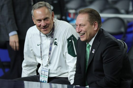 Michigan State head football coach Mark Dantonio, left, sits with head basketball coach Tom Izzo on the sideline before the start of the Spartans' Final Four game against Texas Tech at U.S. Bank Stadium in Minneapolis, Minnesota on Saturday, April 6, 2019.