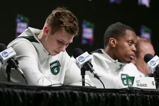 Michigan State guards Matt McQuaid, left, and Cassius Winston answer questions during the postgame news conference, after their Final Four loss to Texas Tech, 61-51, at U.S. Bank Stadium in Minneapolis, Saturday, April 6, 2019.