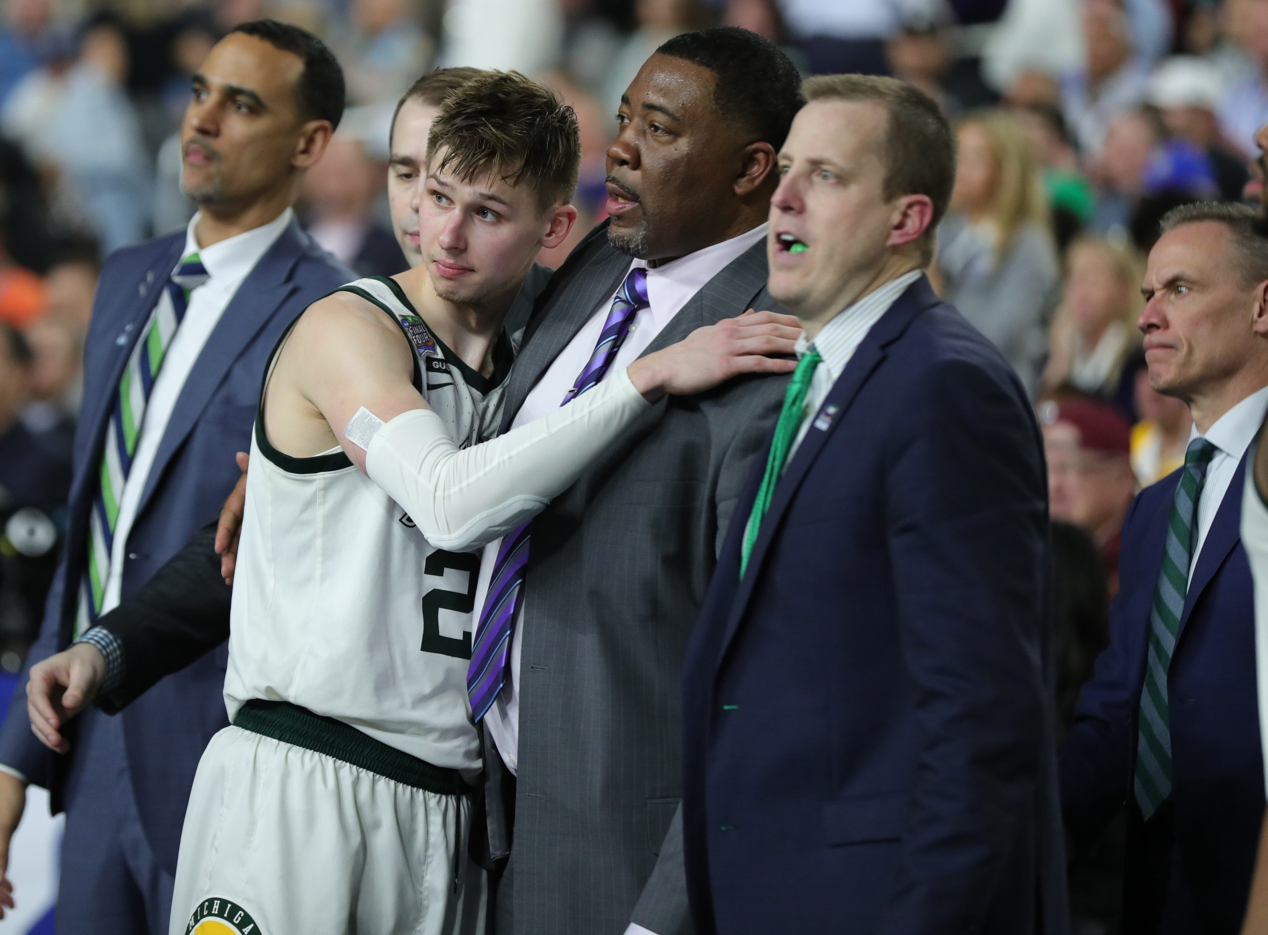 Michigan State guard Matt McQuaid (20) watches from the sidelines in the second half of the Final Four game at U.S. Bank Stadium in Minneapolis, Minnesota on Saturday, April 06, 2019.