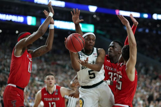 Michigan State guard Cassius Winston (5) looks to pass the ball around Texas Tech defense in the first half of their Final Four game at U.S. Bank Stadium in Minneapolis, Minnesota on Saturday, April 06, 2019.