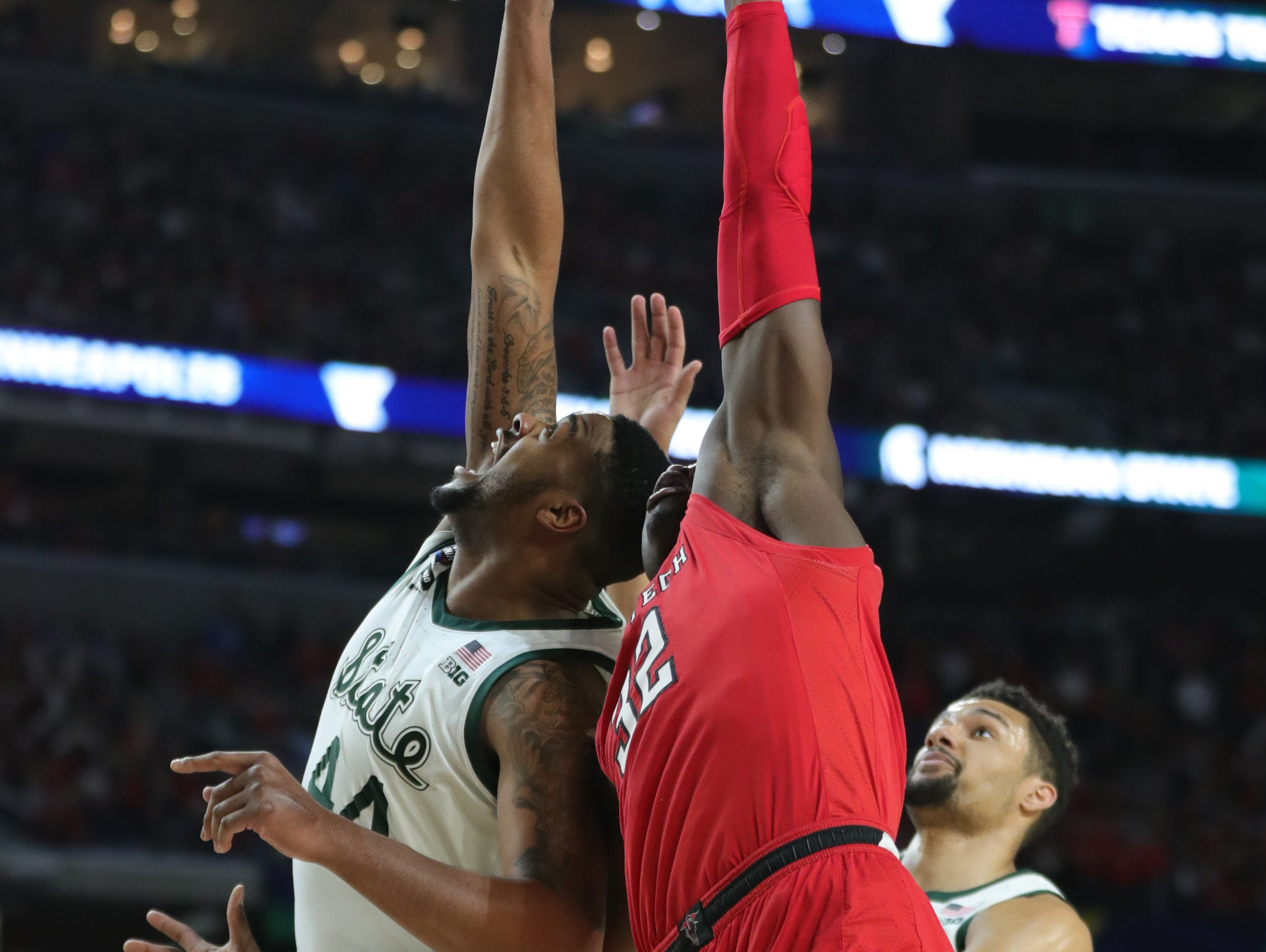 Michigan State Nick Ward (44) and Texas Tech forward Josh Mballa (32) reach for the in the first half of their NCAA Final Four game at U.S. Bank Stadium in Minneapolis, Minnesota on Saturday, April 06, 2019.