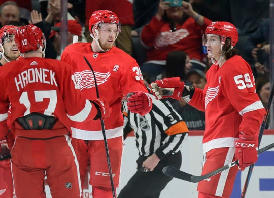 Red Wings right wing Anthony Mantha, center, celebrates his goal against the Sabres with left wing Tyler Bertuzzi (59) and defenseman Filip Hronek (17)  during the first period on Saturday, April 6, 2019, at Little Caesars Arena.