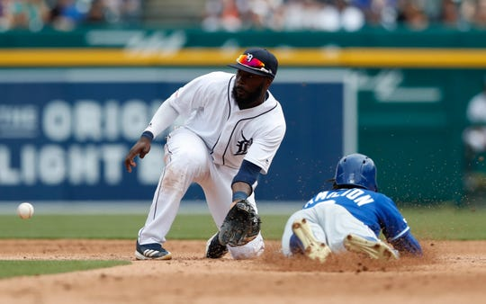 Tigers second baseman Josh Harrison, left, waits on the throw as Royals center fielder Billy Hamilton attempts a steal during the fifth inning on Sunday, April 7, 2019, at Comerica Park. Hamilton was out on the play.