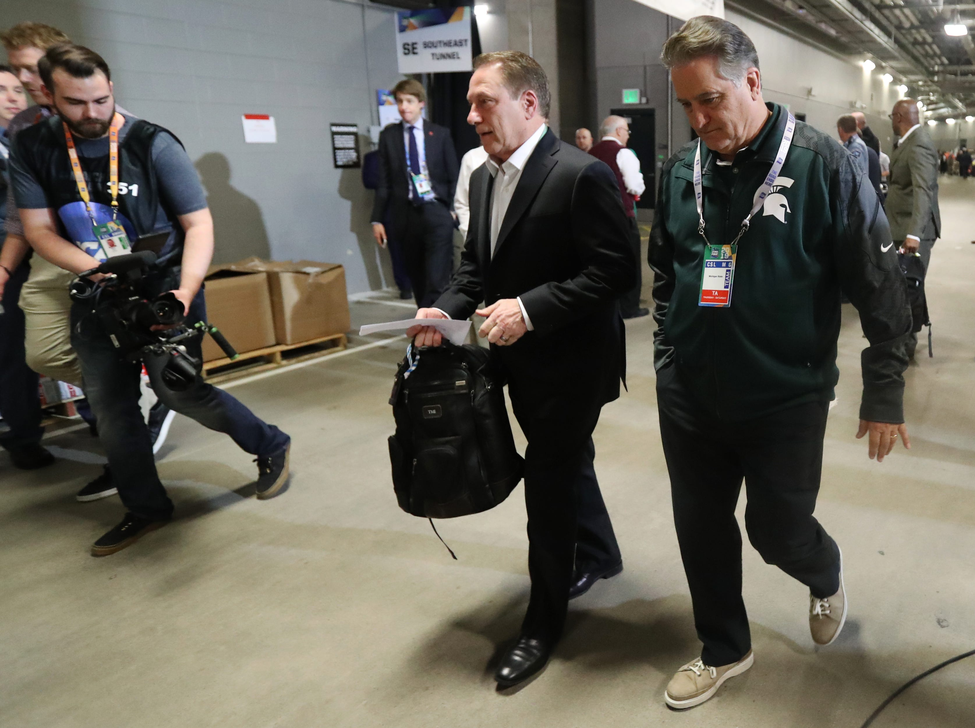 Michigan State head coach Tom Izzo walks with former Detroit Lions coach Steve Mariucci as they arrive for the Final Four against Texas Tech at U.S. Bank Stadium in Minneapolis, Minnesota on Saturday, April 06, 2019.