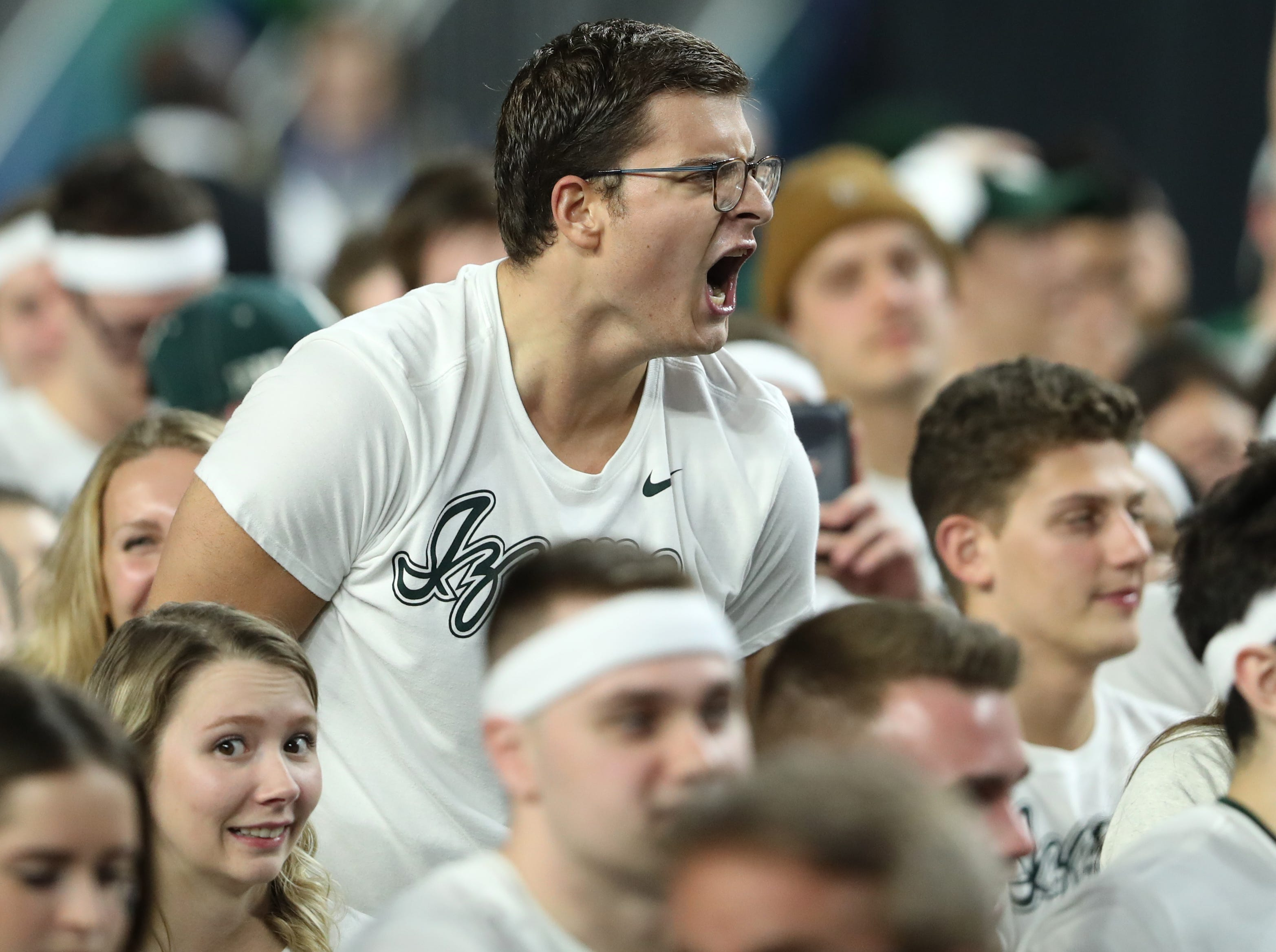 A Michigan State fan reacts in the second half of the Spartan's Final Four game against Texas Tech at U.S. Bank Stadium in Minneapolis, Minnesota on Saturday, April 06, 2019.