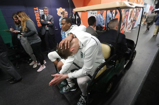 Michigan State guard Cassius Winston consoles teammate Matt McQuaid, after the 61-51 loss to Texas Tech in the Final Four at U.S. Bank Stadium in Minneapolis, Minnesota on Saturday, April 6, 2019.