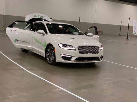 An autonomous Lincoln MKZ available for the Society of Automotive Engineers Demo Days at Cobo Center from April 5 to 7 in 2019. Participants who registered could take a free ride.
