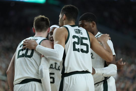 Michigan State huddles in the second half of the Spartan's Final Four game against Texas Tech at U.S. Bank Stadium in Minneapolis, Minnesota on Saturday, April 06, 2019.