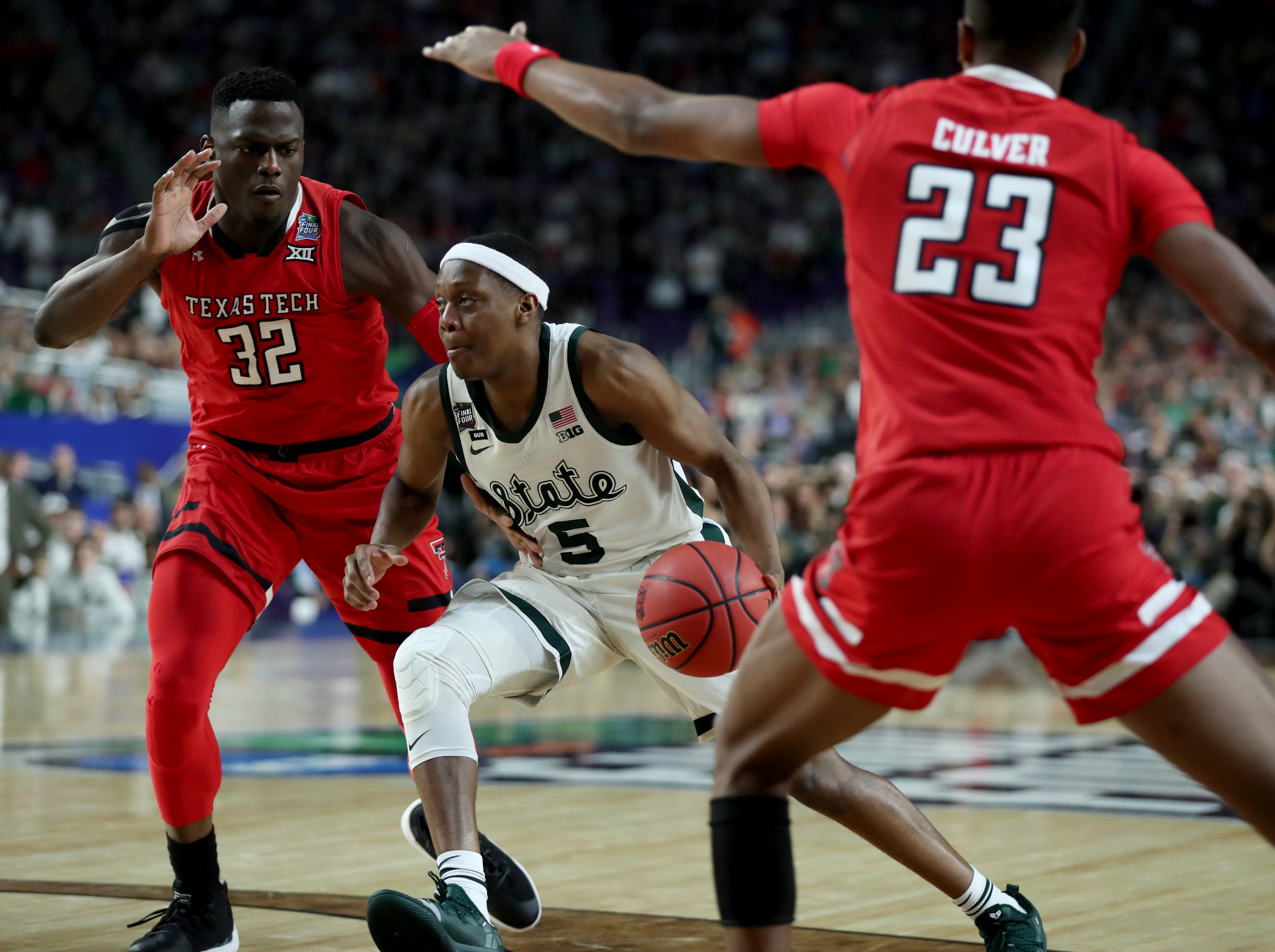Michigan State guard Cassius Winston (5) moves the ball around forward Josh Mballa (32) in the first half of their Final Four game at U.S. Bank Stadium in Minneapolis, Minnesota on Saturday, April 06, 2019.