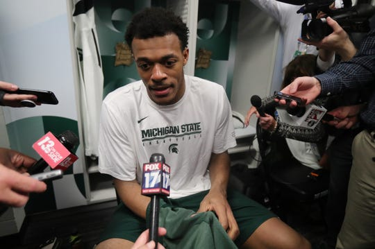 Michigan State forward Xavier Tillman answers questions from the media in the locker room, after the 61-51 loss to Texas Tech in the Final Four at U.S. Bank Stadium in Minneapolis, Minnesota on Saturday, April 6, 2019.