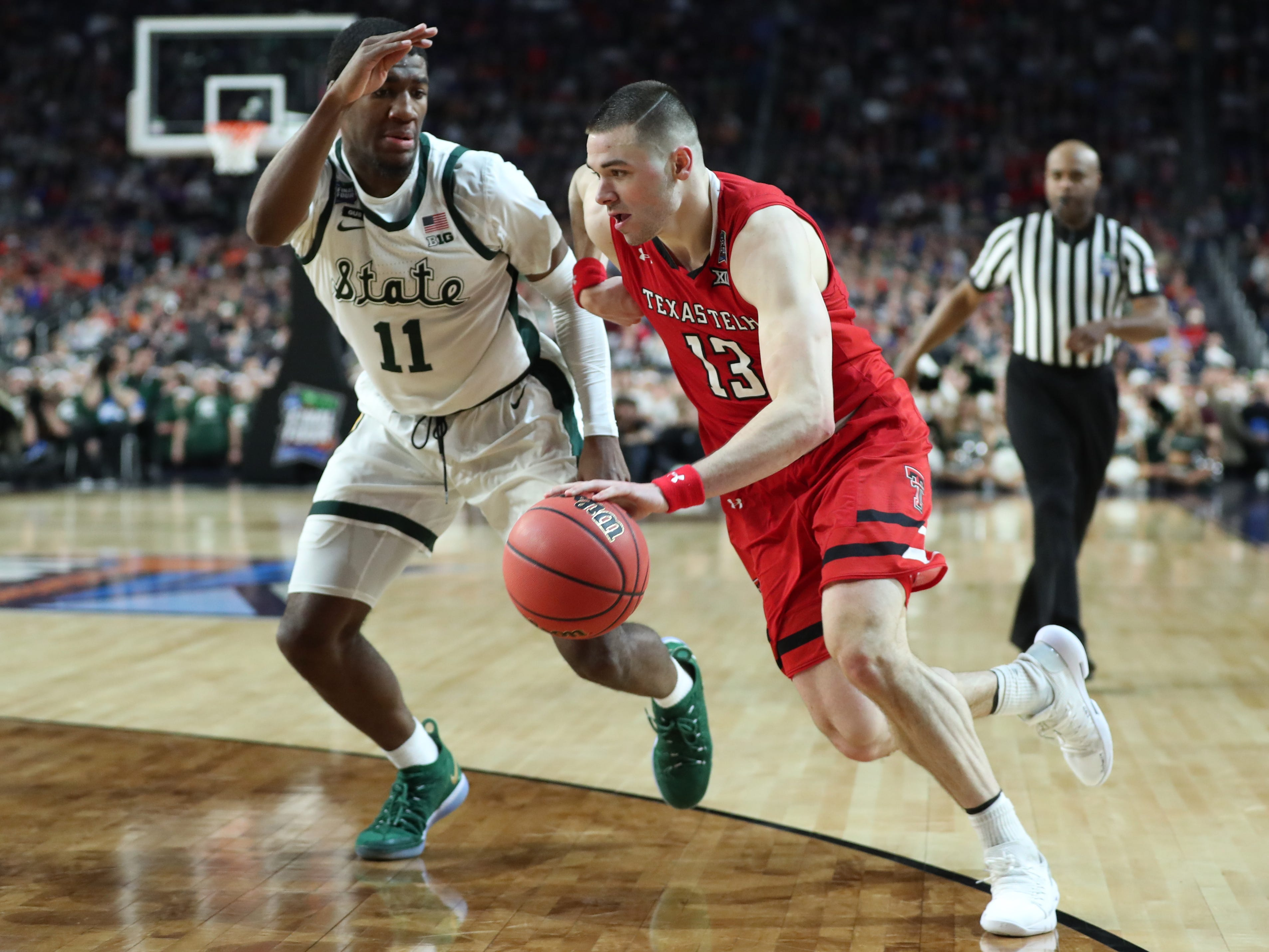 Michigan State forward Aaron Henry defends Texas Tech guard Matt Mooney in the second half of the Final Four game at U.S. Bank Stadium in Minneapolis, Minnesota on Saturday, April 6, 2019.