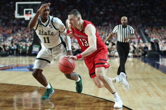 Aaron Henry defends Texas Tech guard Matt Mooney.