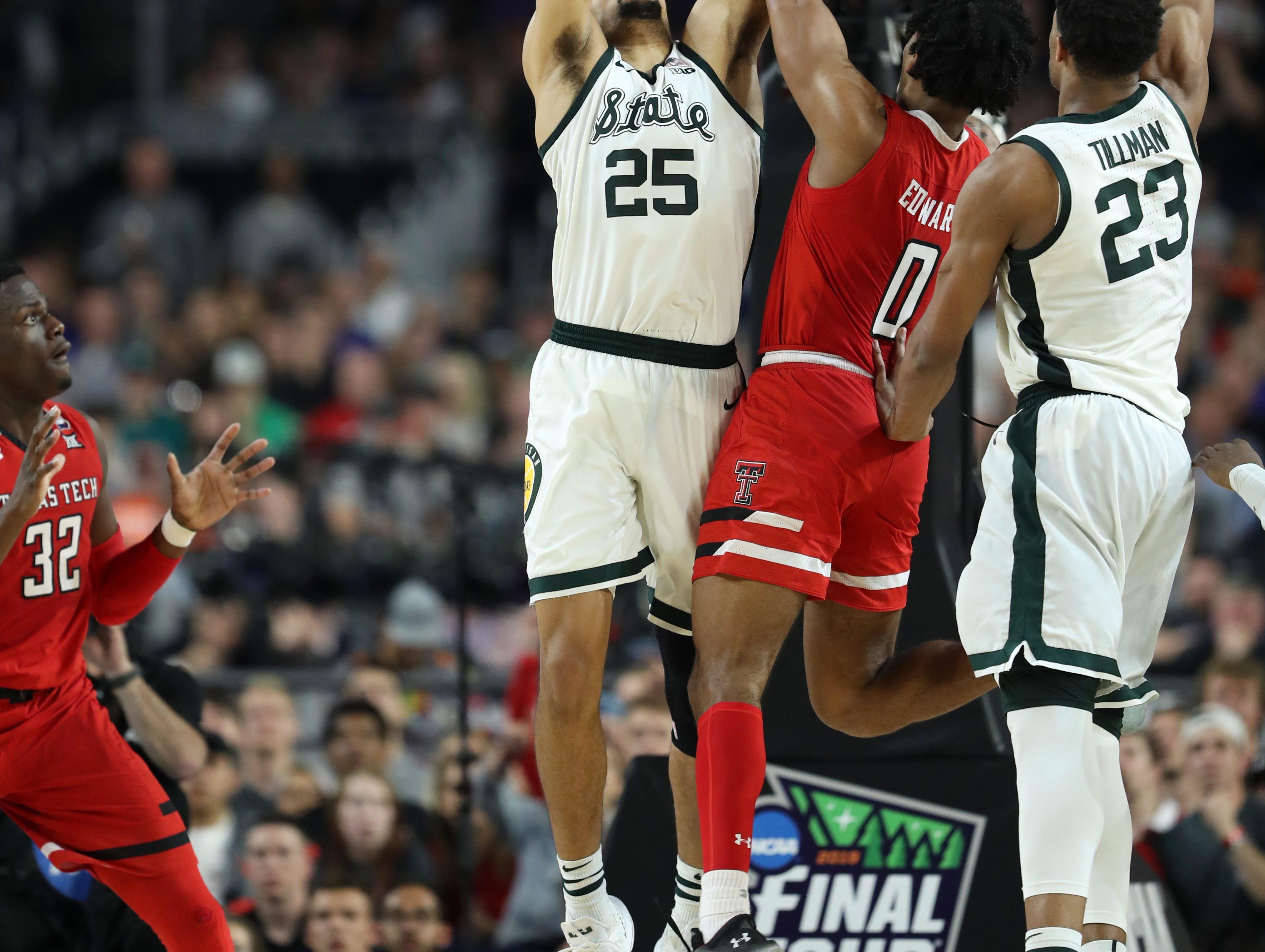 Michigan State forward Kenny Goins (25) guards Texas Tech guard Kyler Edwards (0) in the second half of the Final Four game at U.S. Bank Stadium in Minneapolis, Minnesota on Saturday, April 06, 2019.