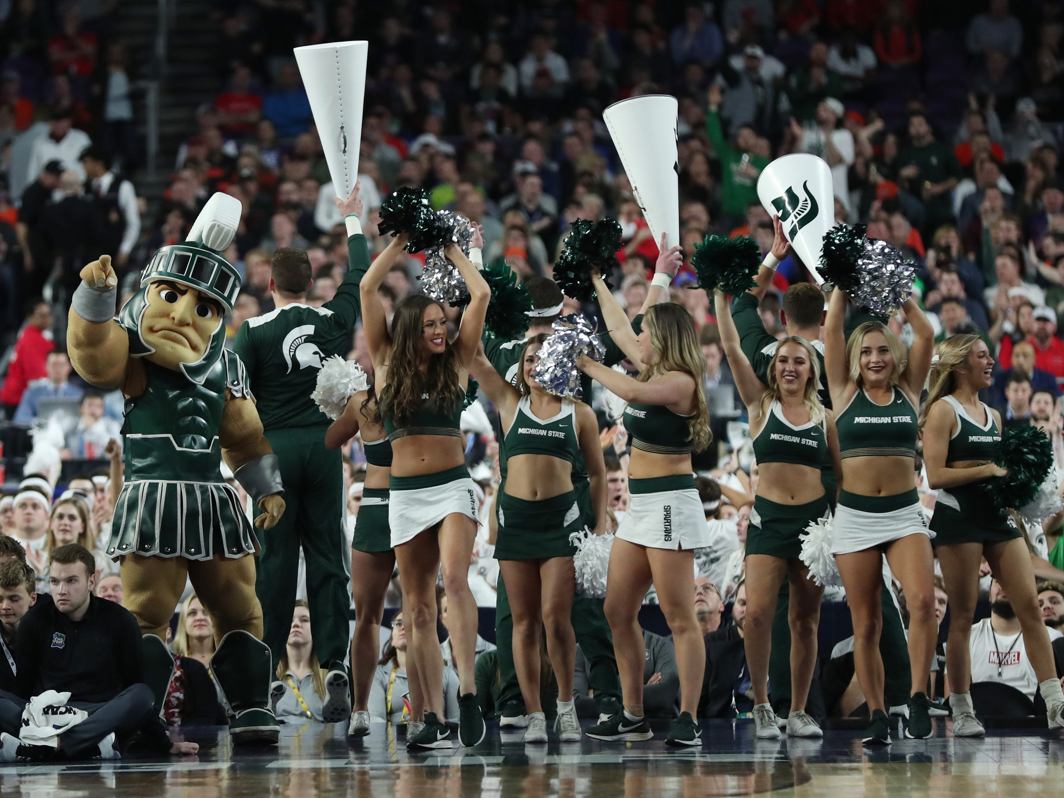 Sparty and the Michigan State cheerleaders in the first half of the Spartans' Final Four game vs. Texas Tech at U.S. Bank Stadium in Minneapolis, Minnesota on Saturday, April 6, 2019.