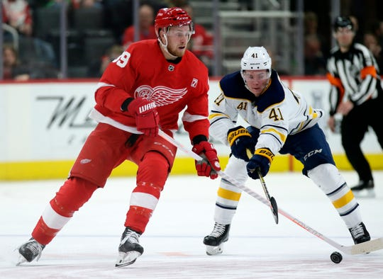 Detroit Red Wings right wing Anthony Mantha (39) has his stick knocked off the puck by Buffalo Sabres left wing Victor Olofsson (41), of Sweden, during the second period of an NHL hockey game Saturday, April 6, 2019, in Detroit. (AP Photo/Duane Burleson)