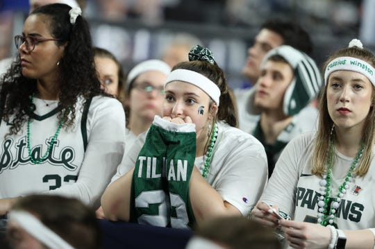 Michigan State fans react in the second half of the Final Four game at U.S. Bank Stadium in Minneapolis, Minnesota on Saturday, April 06, 2019.