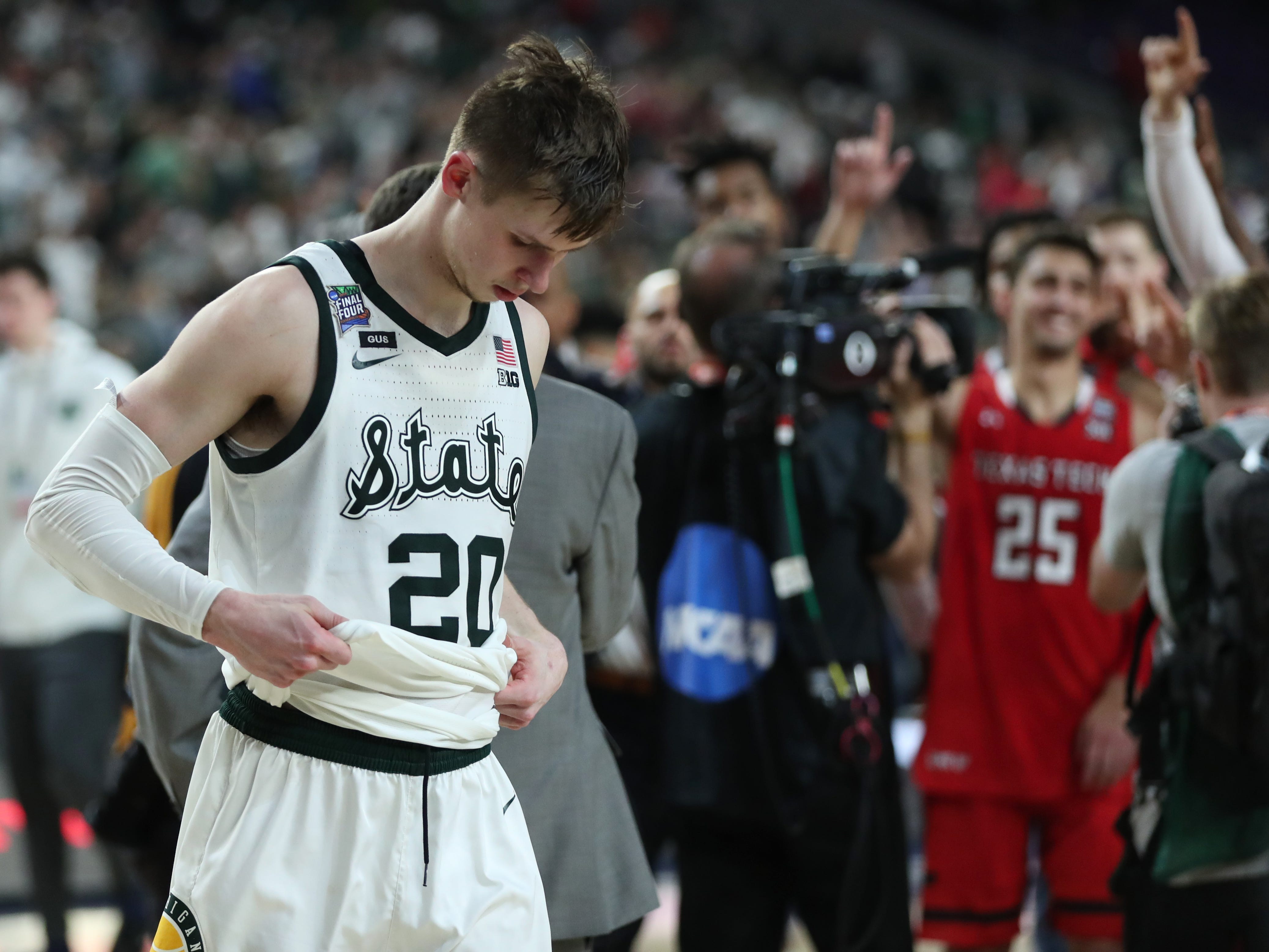 Michigan State guard Matt McQuaid walks off the court after losing in the Final Four to Texas Tech, 61-51, at U.S. Bank Stadium in Minneapolis, Minnesota on Saturday, April 6, 2019.