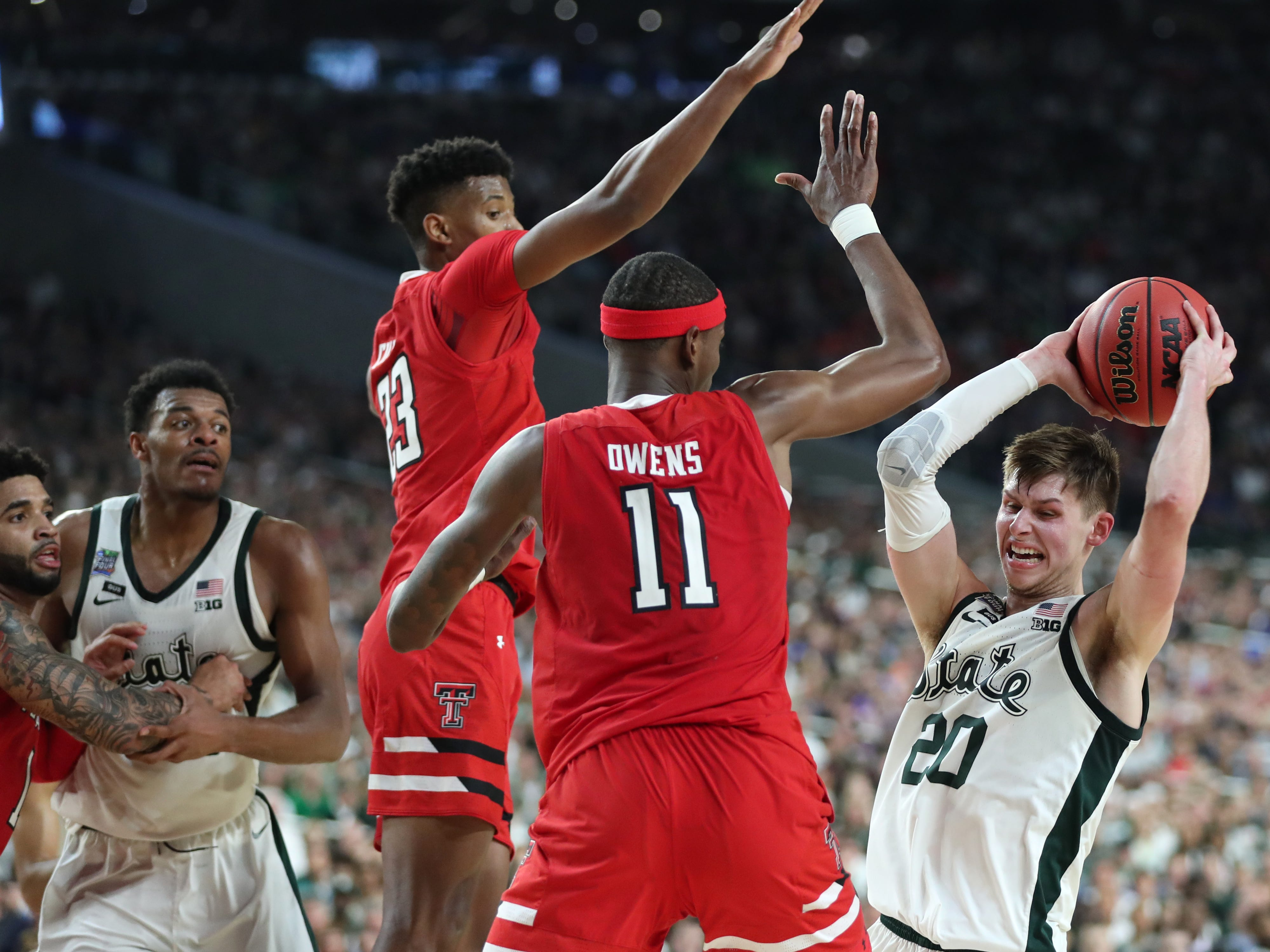 Texas Tech guard Jarrett Culver and forward Tariq Owens  defend Michigan State guard Matt McQuaid in the first half of the Final Four game at U.S. Bank Stadium in Minneapolis, Minnesota on Saturday, April 06, 2019.