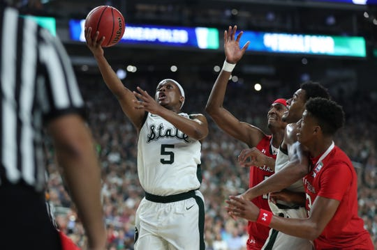 Michigan State guard Cassius Winston (5) looks for a basket around Texas Tech in the first half of the Spartan's Final Four game at U.S. Bank Stadium in Minneapolis, Minnesota on Saturday, April 06, 2019.