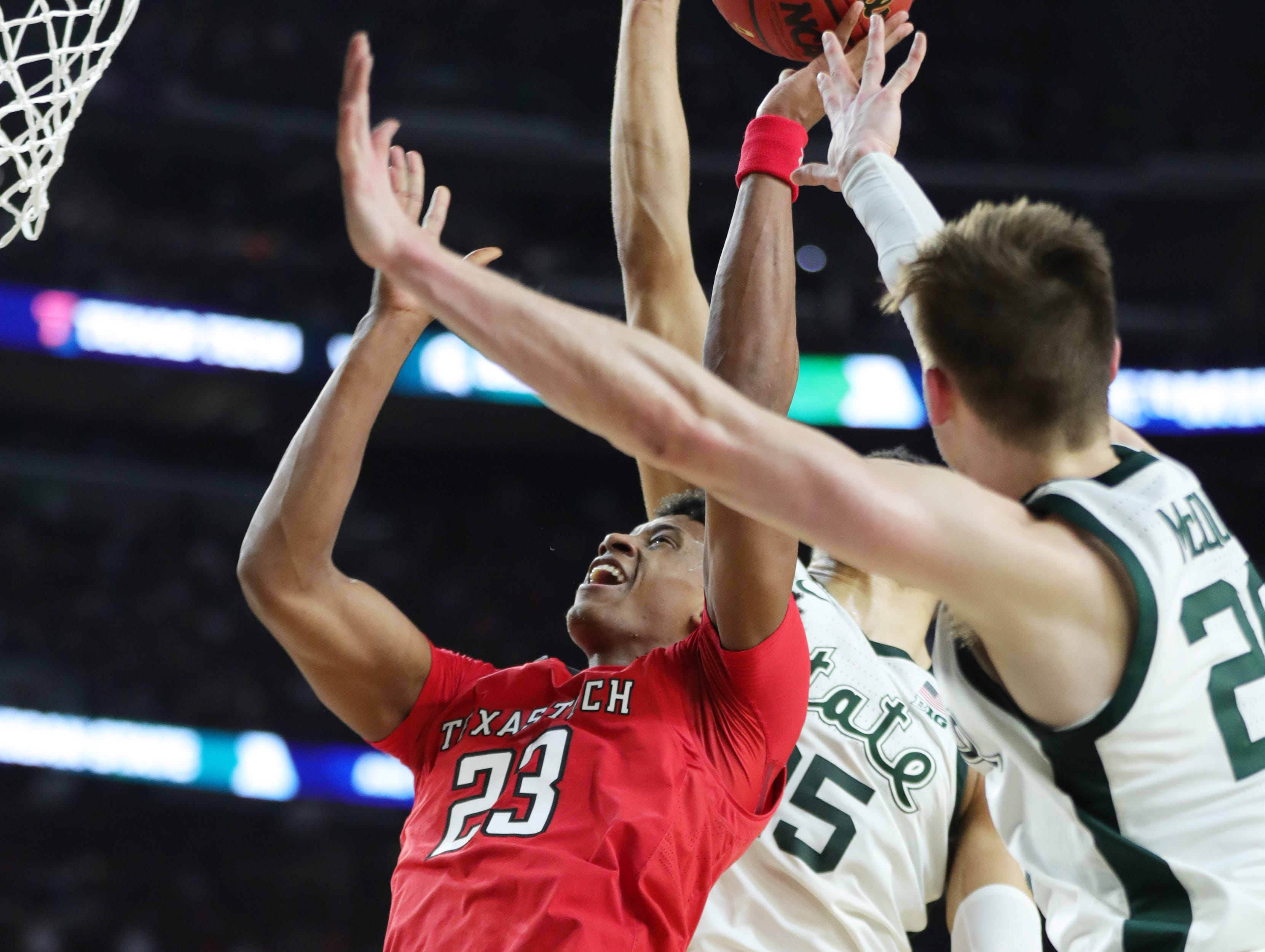 Texas Tech guard Jarrett Culver (23) attempts to shoot around Michigan State forward Thomas Kithier (15) and guard Matt McQuaid (20) during the first half of the Spartan's Final Four game at U.S. Bank Stadium in Minneapolis, Minnesota on Saturday, April 06, 2019.