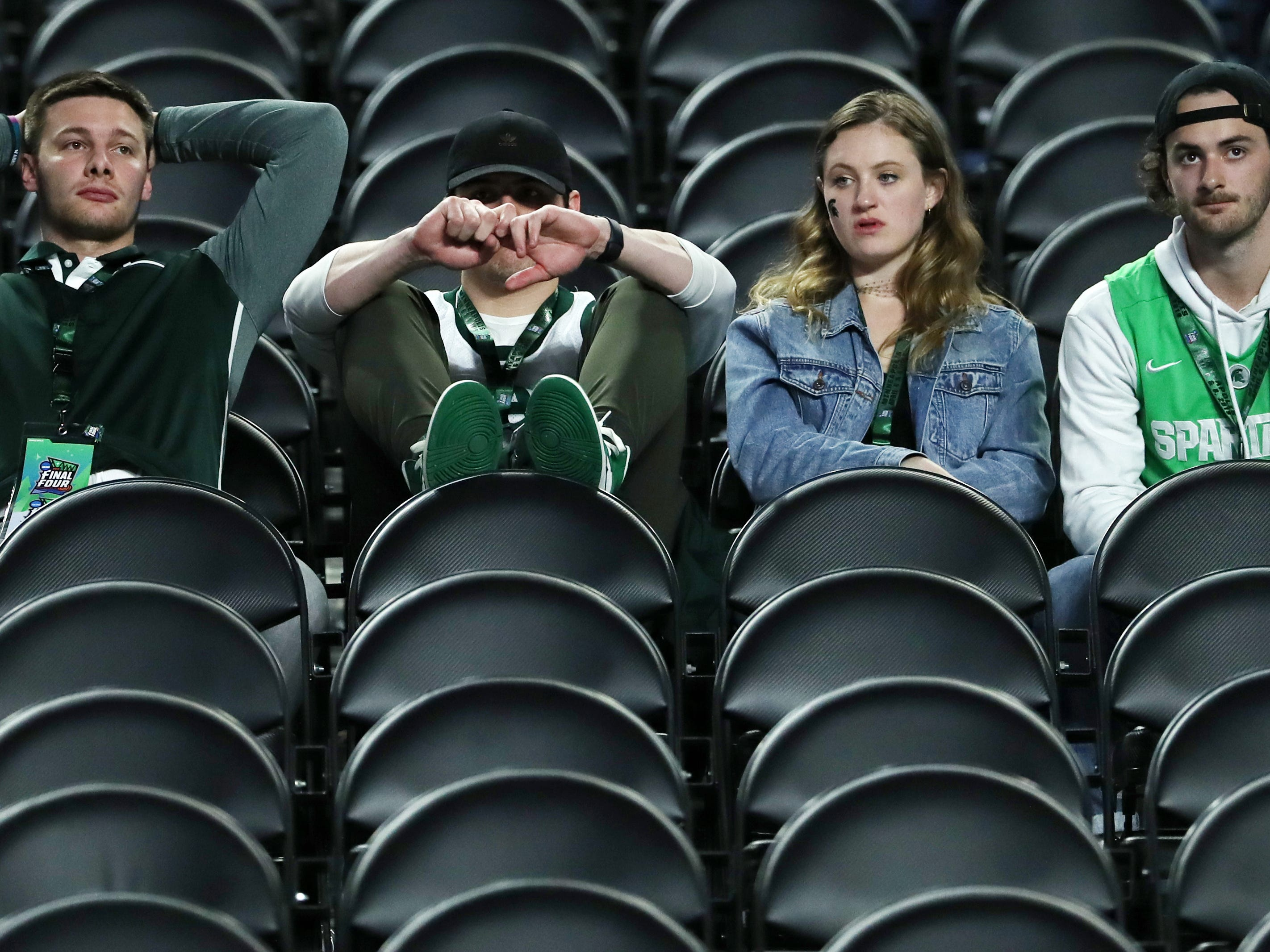 Michigan State fans sit in the stands following the Spartans' loss to Texas Tech, 61-51, in the Final Four at U.S. Bank Stadium in Minneapolis, Minnesota on Saturday, April 6, 2019.