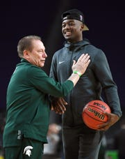 Michigan State head coach Tom Izzo with injured guard Joshua Langford during a practice session for the Final Four Friday, April 5, 2019, in Minneapolis.