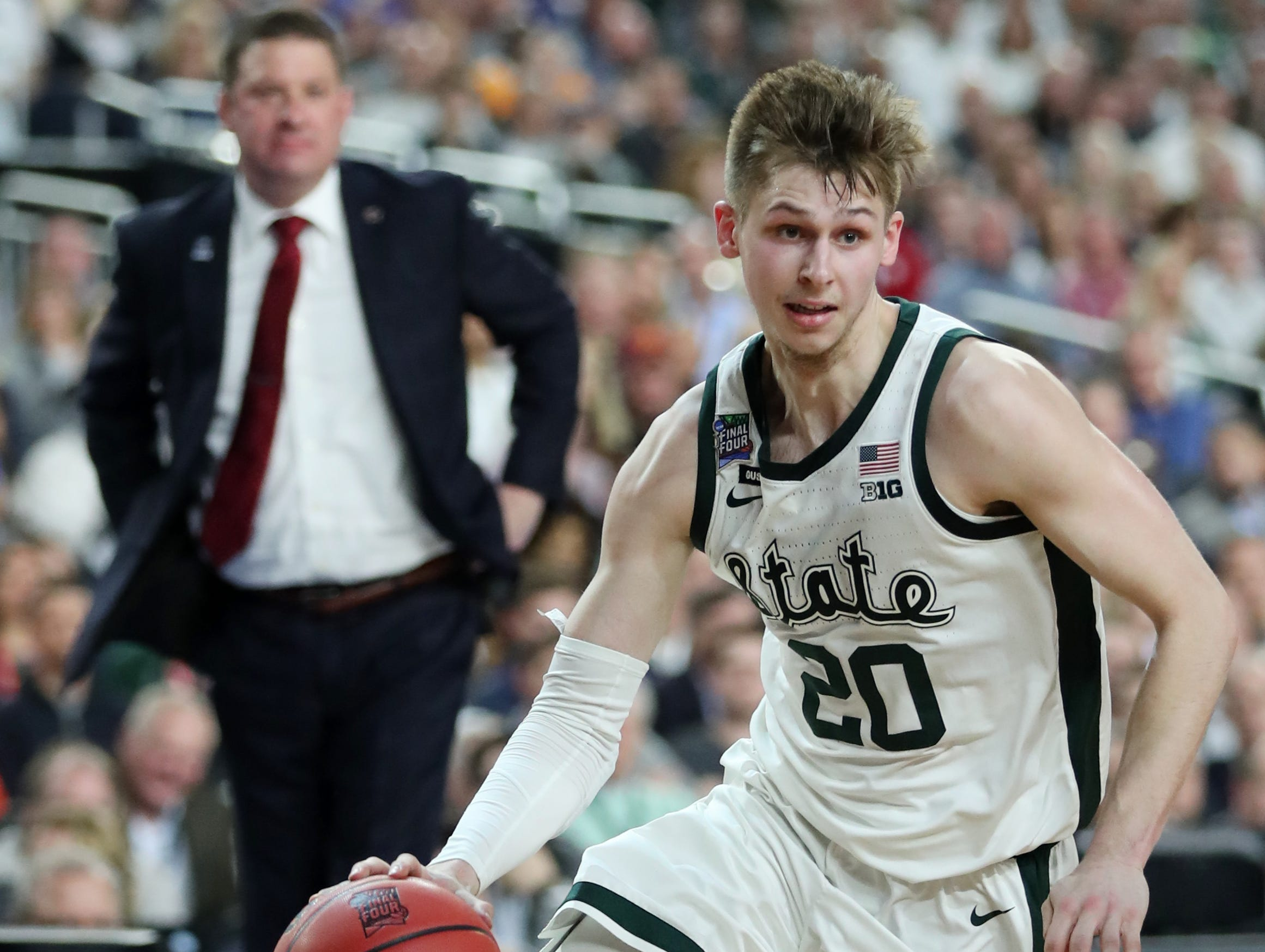 Michigan State guard Matt McQuaid (20) moves the ball down the court in the first half of the Spartan's Final Four game against Texas Tech at U.S. Bank Stadium in Minneapolis, Minnesota on Saturday, April 06, 2019.