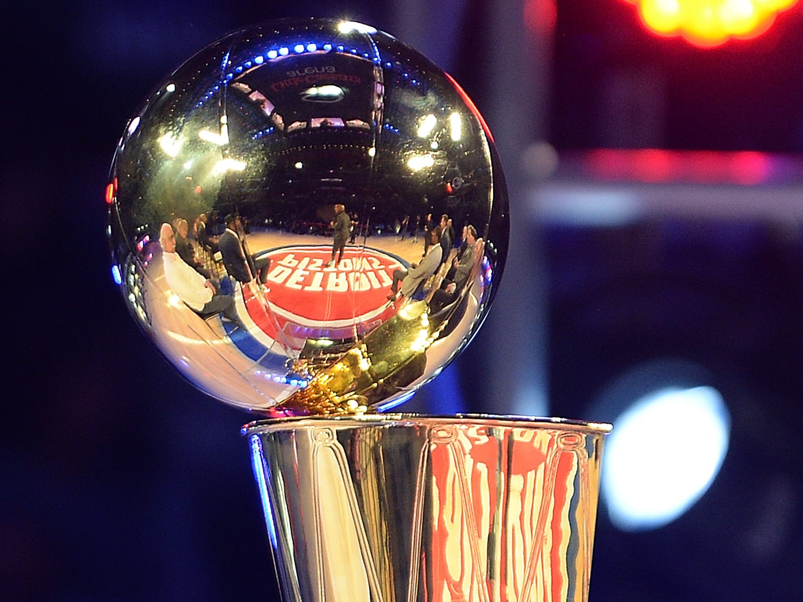 Former Piston Chauncey Billups is reflected in the 2004 Championship trophy during a halftime cermony that honored the team.