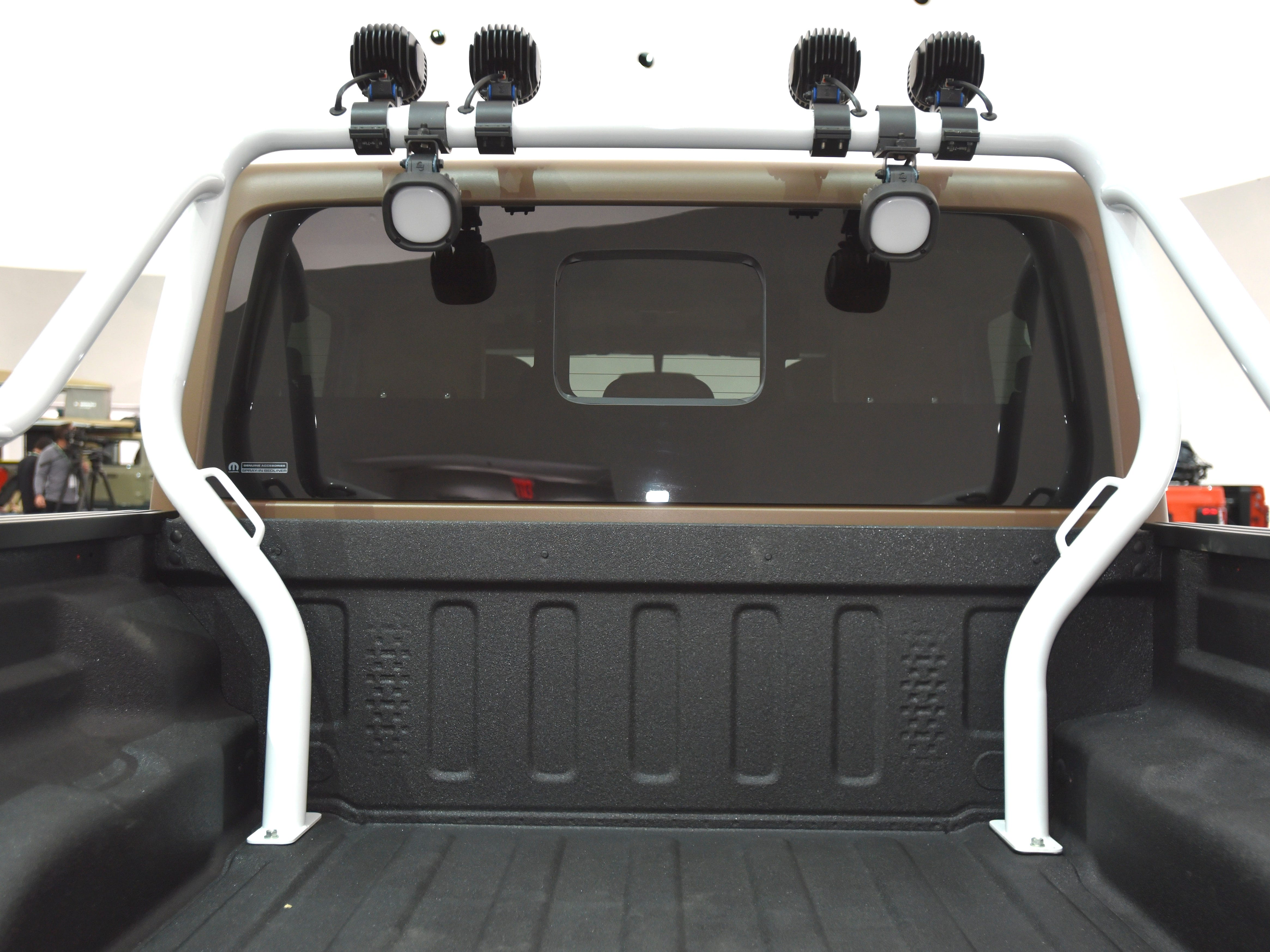 This is a roll bar in the bed of the Jeep JT Scrambler.