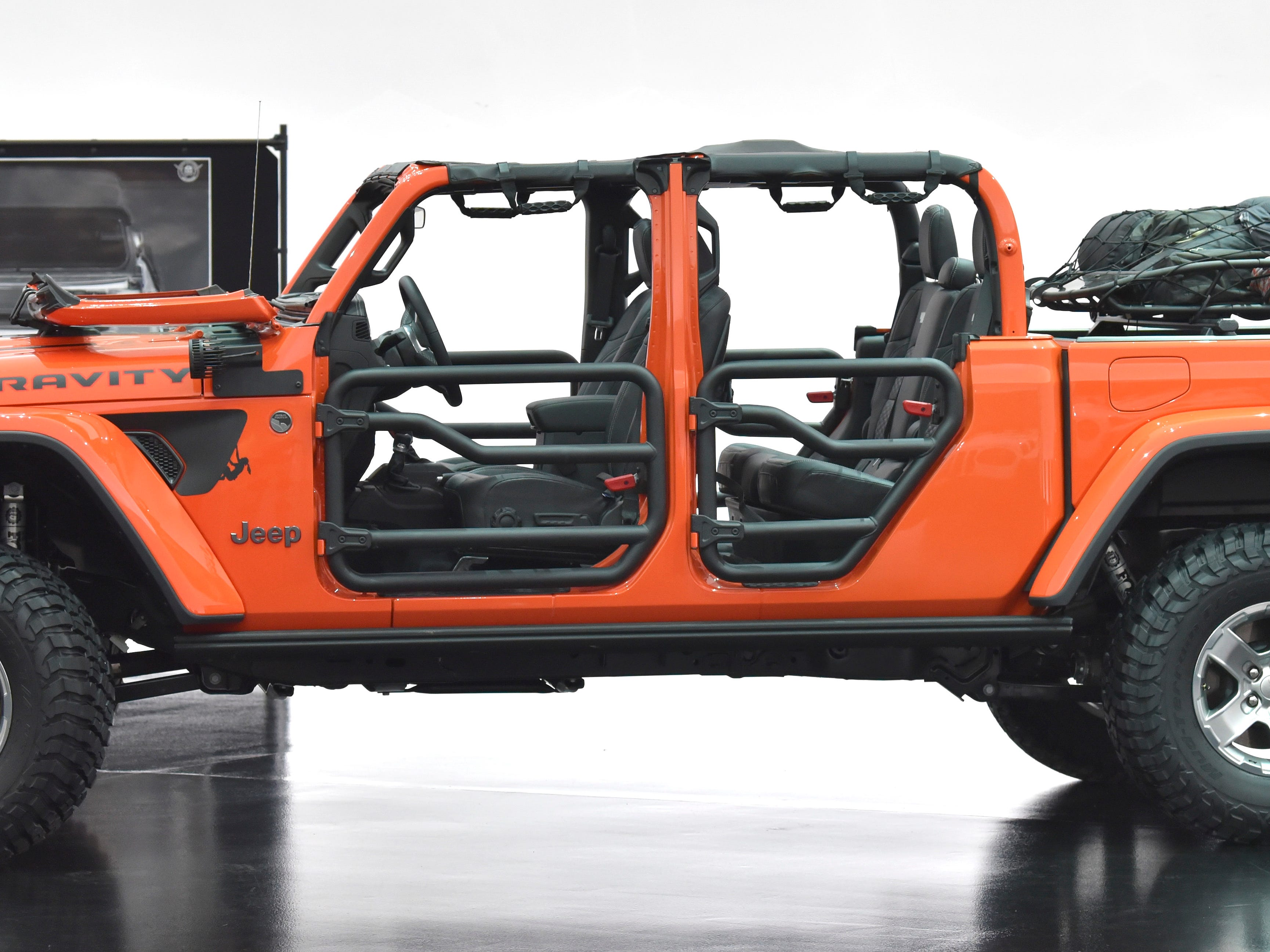 This is the Jeep Gladiator Gravity. This rock-climber-themed concept vehicle is colored in Punk'N Metallic Orange.