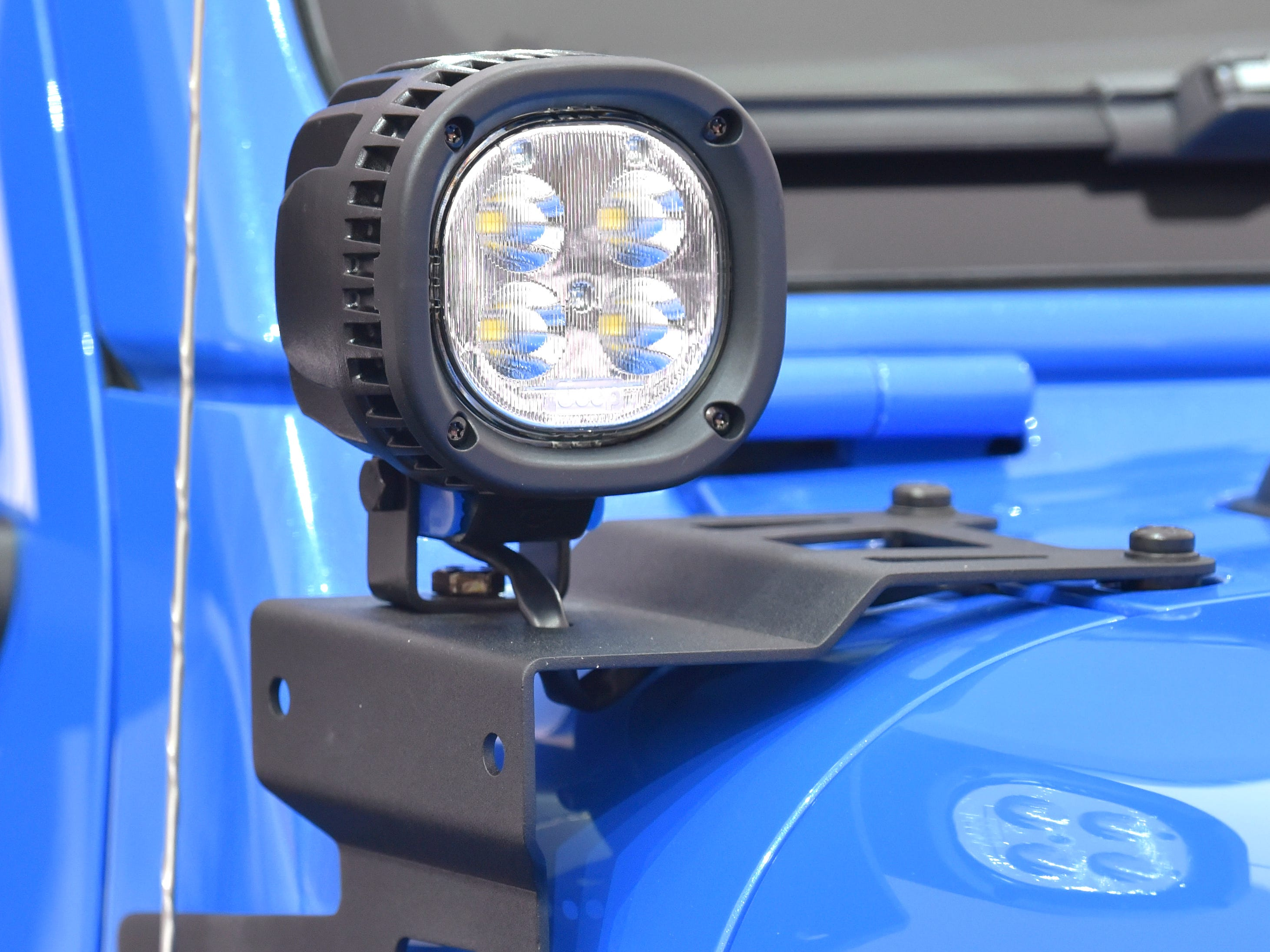This is an LED off-road light on the passenger's side of the Jeep J6 concept in Metallic Brilliant Blue.