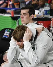 Michigan State's Conner George and Kyle Arenas on the bench late in the second half of the loss to Texas Tech.