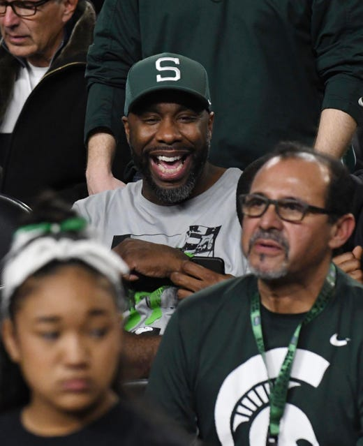 Former Spartan point guard and national champion Mateen Cleaves watches the game.